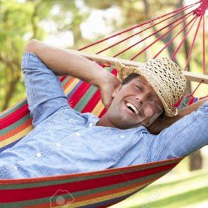 18723075-man-relaxing-in-hammock-stock-photo-rest
